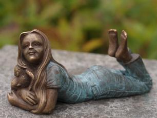 salg af Lying girl with elephant doll